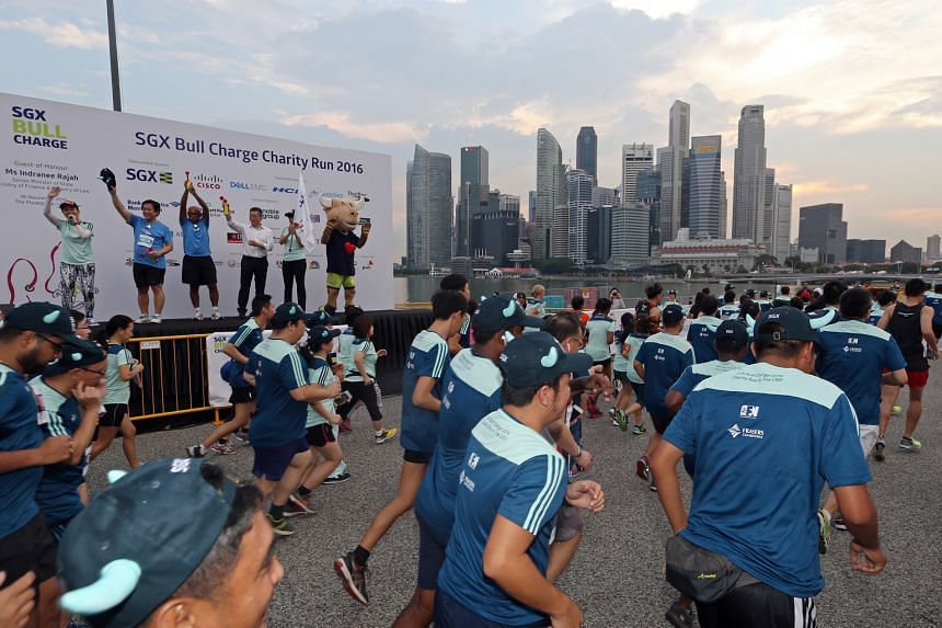 Participants setting off at the start of the 5km mass run of the 2016 SGX Bull Charge Charity Run last Friday. Bull Charge, the Singapore Exchange's flagship charity programme, has raised more than $2.6 million this year. Its grand finale - the annua