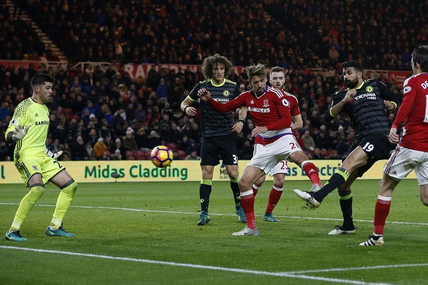 Chelsea's Spanish striker Diego Costa volleying home a loose ball for the only goal of the game against Middlesbrough. His 10th strike of the season has lifted the Blues over Liverpool at the top of the EPL standings.