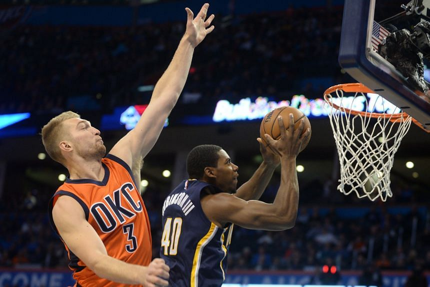 The guard Glenn Robinson III, one of six Indiana Pacers who scored in double figures, going up for a basket after evading the challenge of Oklahoma City Thunder forward Domantas Sabonis at Chesapeake Energy Arena. The Pacers won 115-111 in overtime.