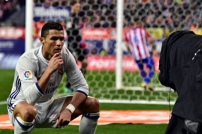 Portuguese forward Cristiano Ronaldo hamming it up for the TV cameras after his penalty gave Real Madrid a 2-0 lead against Atletico on Saturday. His hat-trick brought his derby tally to 18 goals.