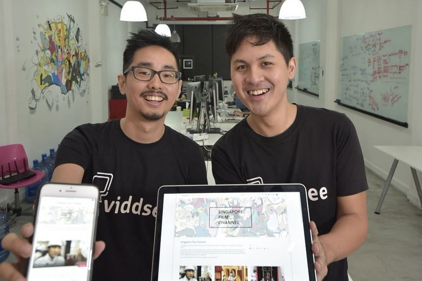 Viddsee co-founders Ho Jia Jian (left) and Derek Tan showing the Singapore Film Channel page on their local video-streaming website.