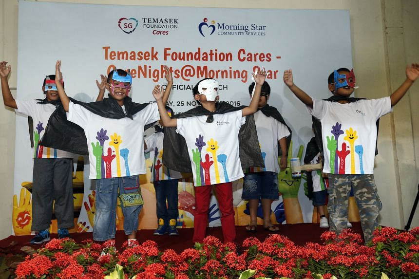 Children performing at the official launch of the CareNights@ Morning Star programme yesterday, at a void deck next to a Morning Star Community Services student care centre in Block 95, Bedok North Avenue 4. The free student care service is being pil