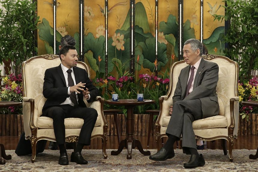 Brunei's Crown Prince Al-Muhtadee Billah (left), in town for the fourth Singapore-Brunei Young Leaders' Programme, calling on Singapore PM Lee Hsien Loong at the Istana yesterday.