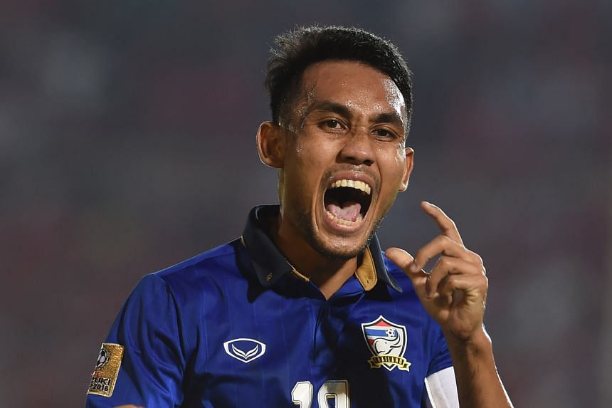 Thailand captain Teerasil Dangda celebrates after scoring against Myanmar during the AFF Suzuki Cup semi-final first leg match in Yangon. His brace earned Thailand a 2-0 win and Kiatisuk Senamuang's men look set for a third straight final appearance.