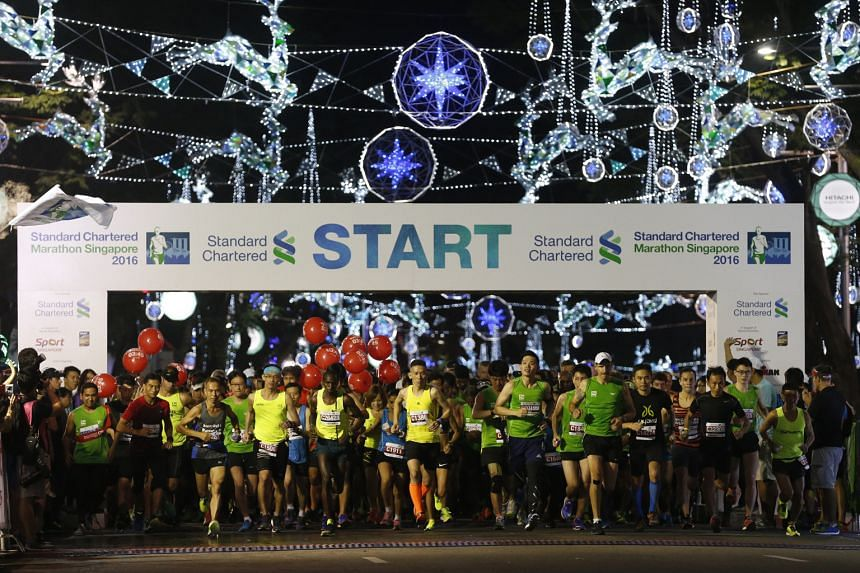 Top: The main group of runners being flagged off at Orchard Road. Above: John Gibson, a Hong Kong-based Briton, died in SGH after collapsing about 1km before the end of the half-marathon.