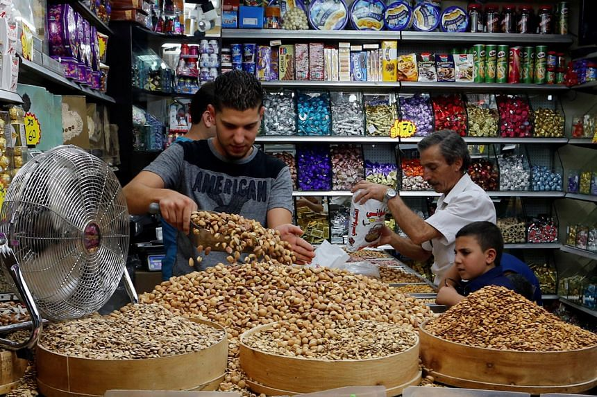 A shop in Jerusalem selling sweets and nuts. Nuts are high in protein and fat.
