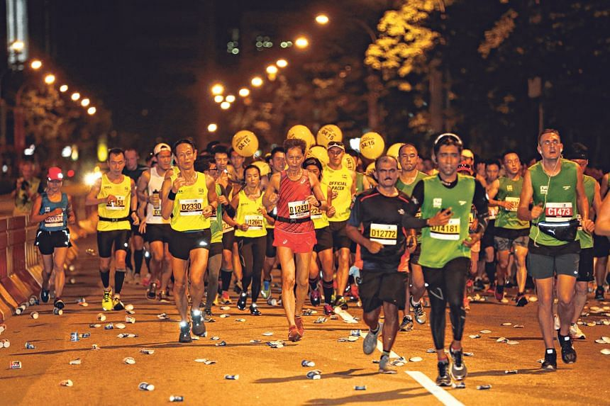 Marathon and half-marathon participants running along Marina Boulevard. Both the 42.195km and 21.1km events were were flagged off at 4.30am on Sunday, with runners finishing at the Padang.