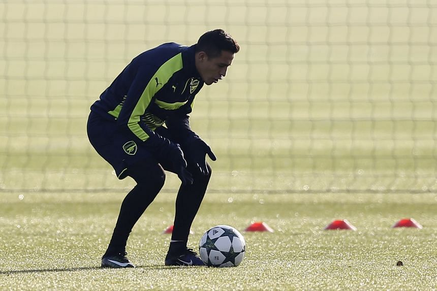 Arsenal's Alexis Sanchez, who scored a hat-trick in their 5-1 rout of West Ham on Saturday, trains for their final Champions League group-stage match against FC Basel.