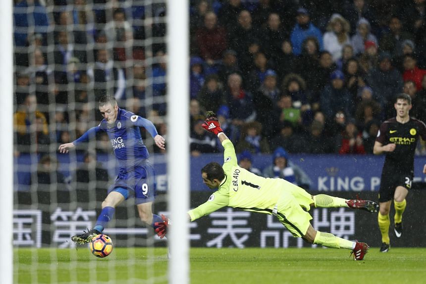 Leicester City's Jamie Vardy rounding Manchester City goalkeeper Claudio Bravo before scoring his third goal of the match. The Foxes won the Premier League clash 4-2.