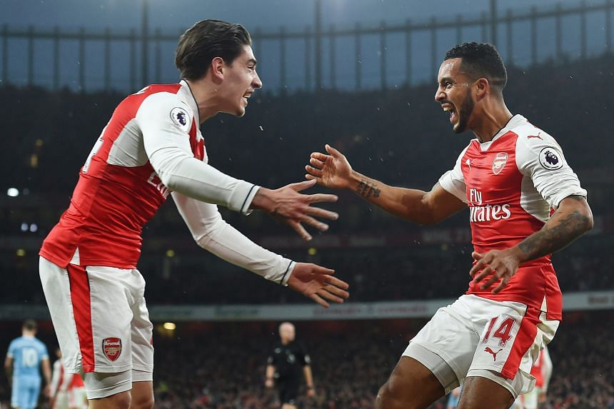 Arsenal's Theo Walcott (right) celebrating with Hector Bellerin after scoring in the 3-1 Premier League win over Stoke City. The Gunners are on a run of three successive victories in all competitions.