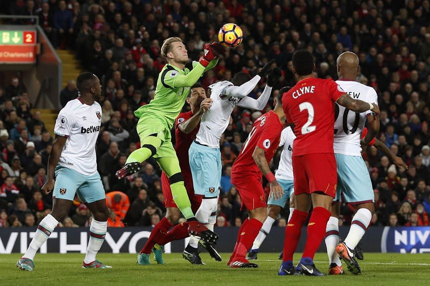 Liverpool goalkeeper Loris Karius fisting the ball away during a set-piece situation against West Ham. The German, in his debut Premier League season, has been under fire with his displays between the sticks in the Reds' last two games against the Ha