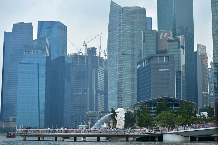 Cited among the dividend plays for the year ahead is Keppel Reit, whose portfolio includes prime office assets such as Marina Bay Financial Centre (above).