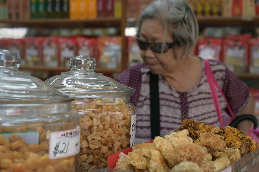 Dried scallops in a jar in shops in Chinatown where people do their Chinese New Year shopping. The prices of traditional New Year delicacies, including abalone, have risen this year due to decreasing production. Some retailers are absorbing the price