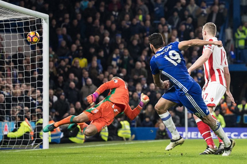 Chelsea striker Diego Costa (above) smashing in his 14th Premier League goal of the season to put the Blues in front for a third time against Stoke City on Saturday.