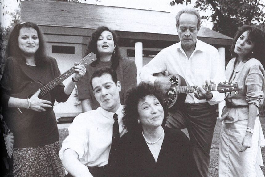 """Mr Barker with family members (from left) Carla, Deborah, Brandon, Gloria and Gillian. Mrs Barker says her husband was """"always playing the guitar but he never knew the words of any song""""."""