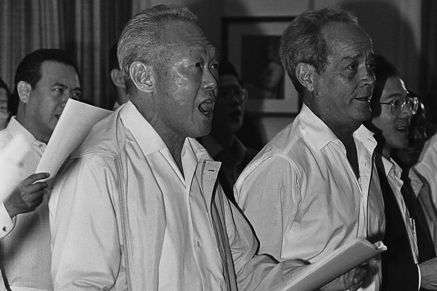 Mr Barker with Mr Lee Kuan Yew and other ministers and MPs during a National Day rehearsal at Parliament House in 1987.