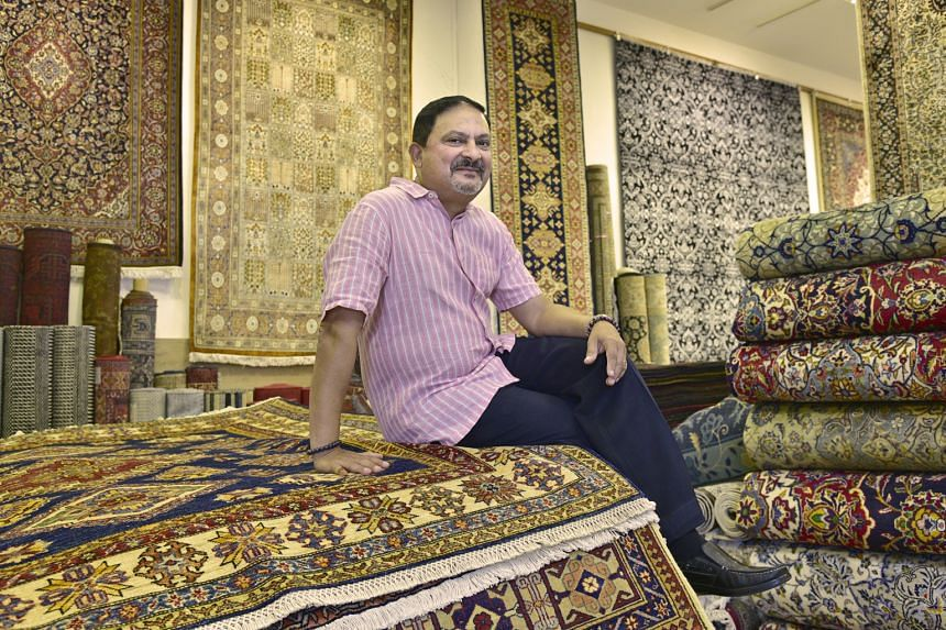 At 21, fresh out of the army, Mr Hedger (above) applied to become a carpet salesman because he needed money to complete his studies. It led to an intense love affair with carpets, rugs and runners, resulting in him being the only Eurasian in the loca