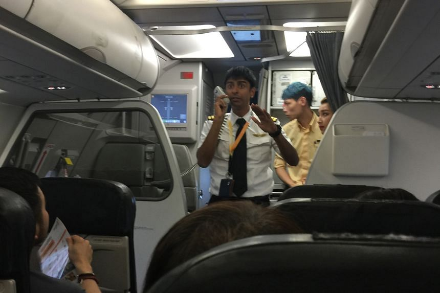 One passenger, Mr Lam, praised the pilot (above) for the calm handling of the situation and the professionalism of the whole crew.