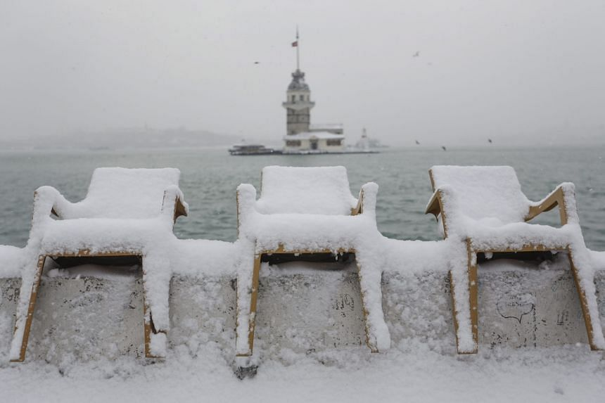 Snow-covered chairs along the Bosporus in Turkey on Sunday. The strait is closed to ships due to the severe weather.