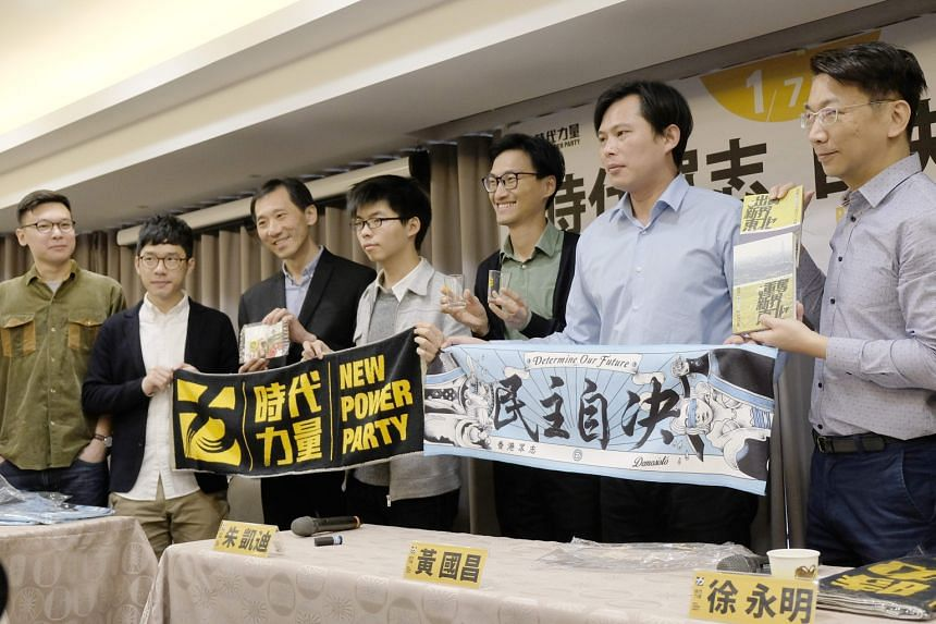 (From left) Taiwan Sunflower Movement leader Lin Fei-fan, Hong Kong politicians Nathan Law, Edward Yiu, Joshua Wong and Eddie Chu, and Taiwan lawmakers Huang Kuo-chang and Hsu Yung-ming at an event hosted by the New Power Party in Taipei on Sunday, a