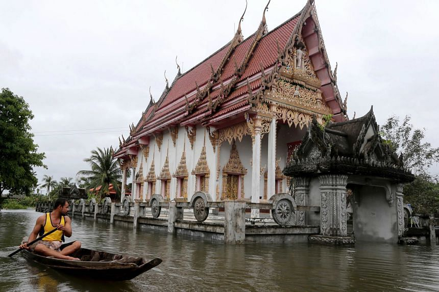 A flooded Buddhist temple in Nakhon Si Thammarat province, in southern Thailand, on Sunday. Since the start of the year, heavy rain has caused flooding across several provinces in the southern provinces, leaving at least 21 people dead and affecting