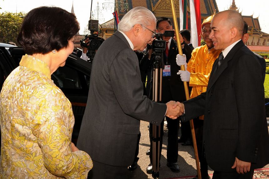 President Tony Tan Keng Yam and his wife on arrival at the Royal Palace where they are greeted by King Norodom Sihamoni. Dr Tan, who is on a four-day state visit, will go to Siem Reap today.