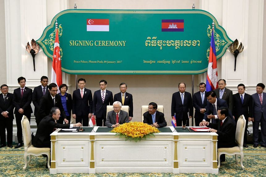 President Tony Tan Keng Yam sitting next to Cambodian Prime Minister Hun Sen at the signing of two agreements yesterday that will see cooperation in vocational training for infocommunications technology, electronics and automotive technology, as well