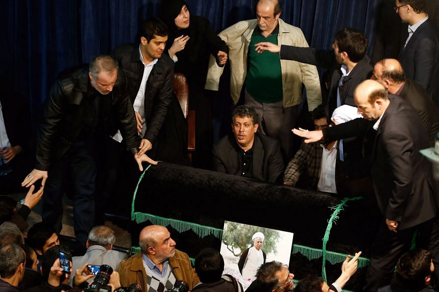 Mourners surrounding his coffin during a ceremony at the Jamaran mosque in Teheran, Iran.