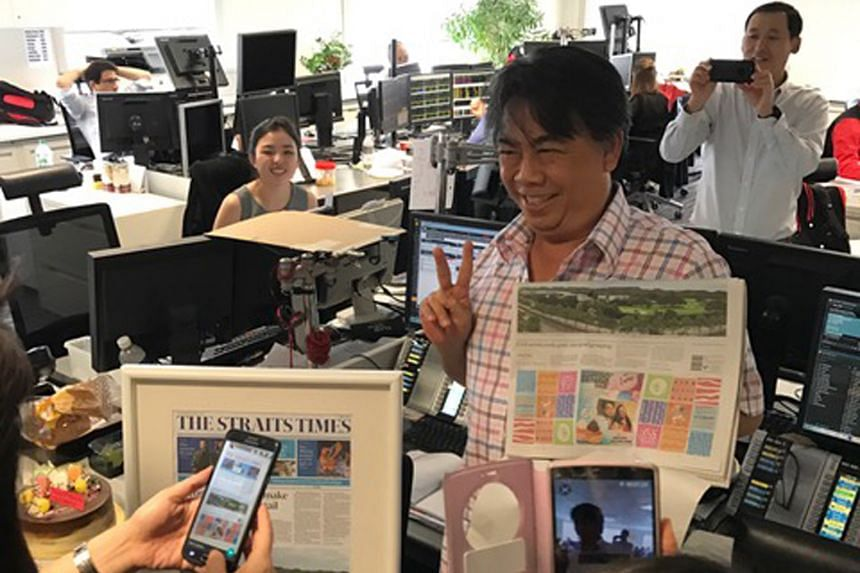 Mr Raymond Lim's birthday surprise was delivered to him at his office during lunchtime, together with a cake and a bottle of champagne.