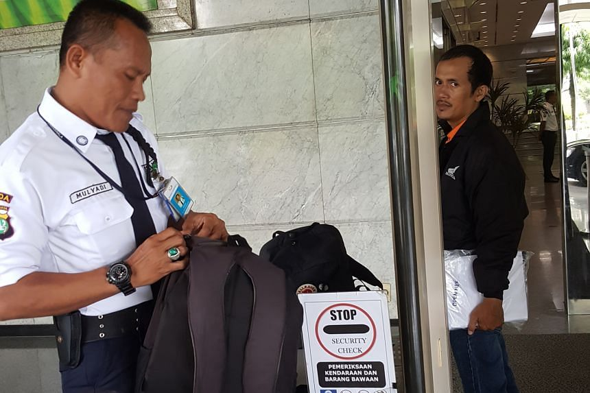 Security guard Mulyadi checks every bag at the mall and screens everyone, including staff.
