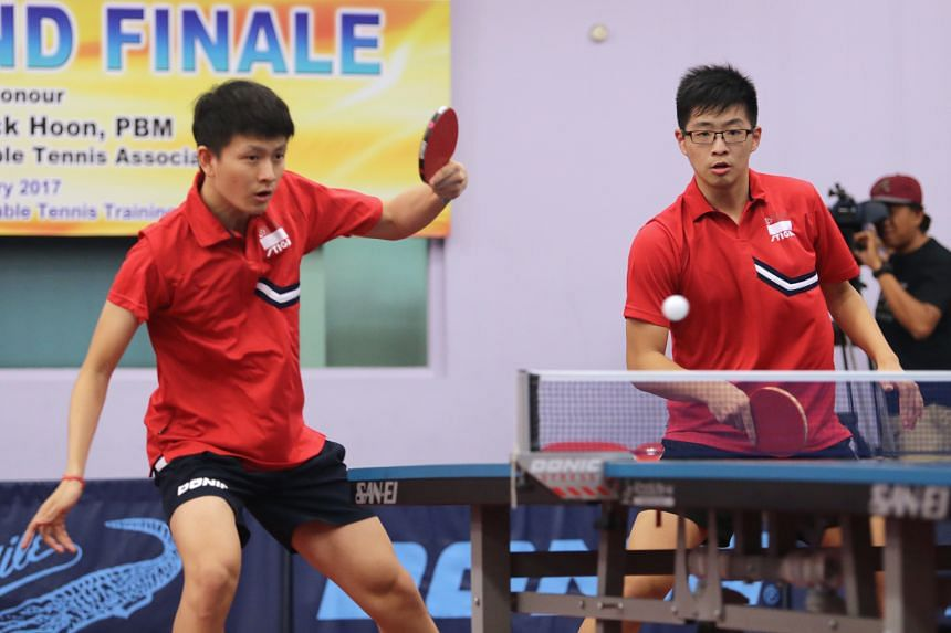 Clarence Chew (left) and Ethan Poh competing in the National Grand Finale men's doubles final against Pang Xue Jie and Bernard Tan. They won 11-9, 8-11, 11-5, 11-6.