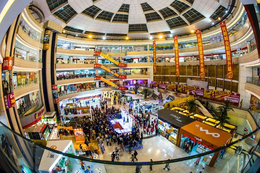 Dasin Retail Trust, which owns three malls in Zhongshan, including the Shiqi Metro Mall (above), kicked off its S$146 million IPO this month. Singtel is also expected to list NetLink Trust in the second half of the year for about US$2.5 billion (S$3.