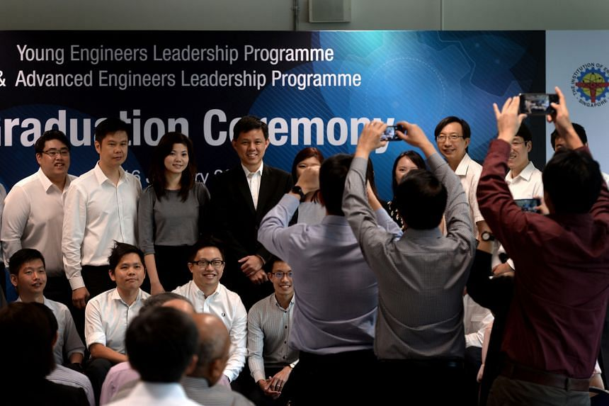 Minister Chan Chun Sing (centre, in black) with the engineers who had undergone training programmes organised by NTUC and the Institution of Engineers, Singapore. The programmes are part of an industrywide career development plan to help engineers mo
