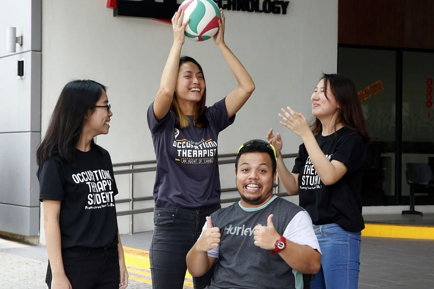 Students from the SIT occupational therapy degree course (from left) Lydia Tham, 20, Cheryl Lee, 20, and Lim Jiayi, 21, interacting with 29-year-old Aidil Khalip, who lost a leg in a motorcycle accident four years ago and now plays wheelchair rugby.