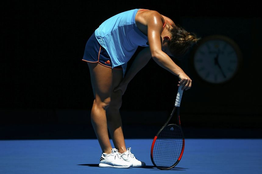Romanian Simona Halep clutching her knee during her first-round match against Shelby Rogers of the United States. The world No. 4 revealed after her straight-sets loss that she has a knee injury and first felt a tendon problem in October at the WTA F