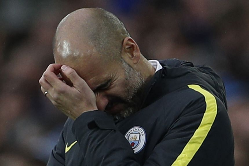 Pep Guardiola scratching his head as he seeks to turn Manchester City's fortunes around. His side have lost four of their last eight league games.