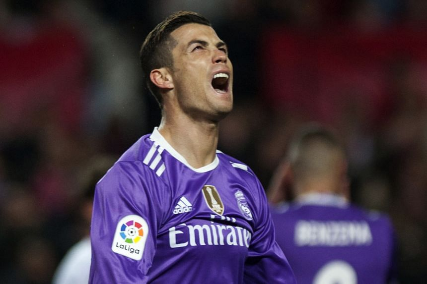 Real forward Cristiano Ronaldo shows his frustration after his side concede late at Sevilla. The Portuguese gave Madrid the lead from the spot, becoming the joint-top penalty scorer in La Liga history.