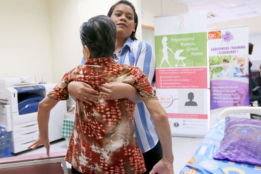Madam Nur Fadzelah Sapullah demonstrates some of the skills she learnt when she joined the eldercare training programme last November. For example, one lesson was how to properly carry an elderly patient so that both patient and caregiver are safe.