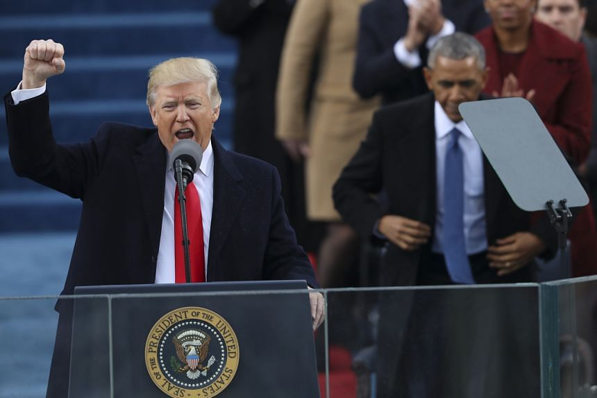 "Mr Donald Trump acknowledging the crowd at the US Capitol in Washington, DC, after being sworn in as the 45th US President. He vowed that the country would ""follow two simple rules: buy American and hire American""."