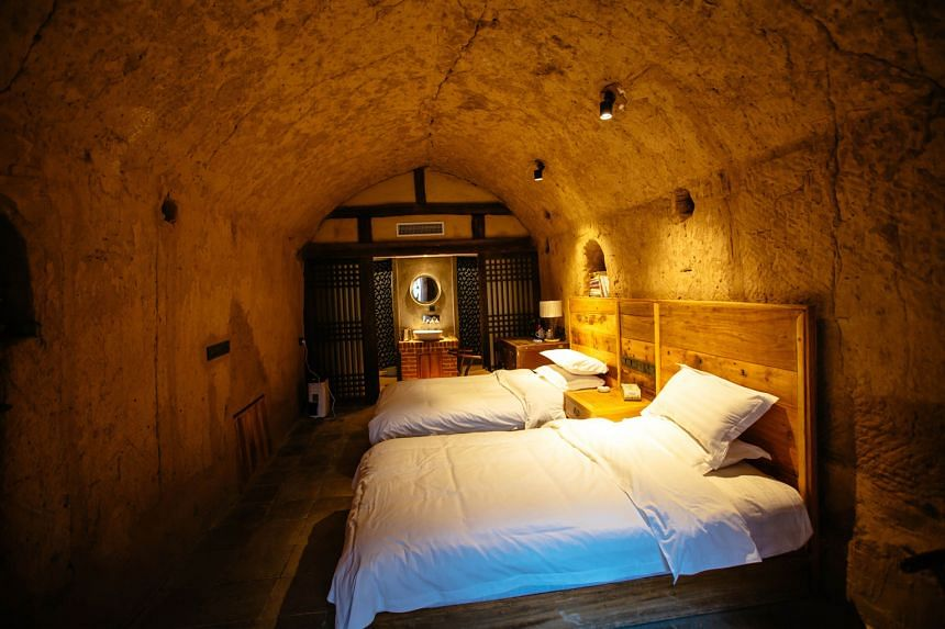 The interior and exterior of an old cave dwelling that has been converted into a boutique hotel in Mengzhou, in China's Henan province. Cave dwellings were an ancient way of life in the mountainous region. With more than 180 cave dwellings still rema