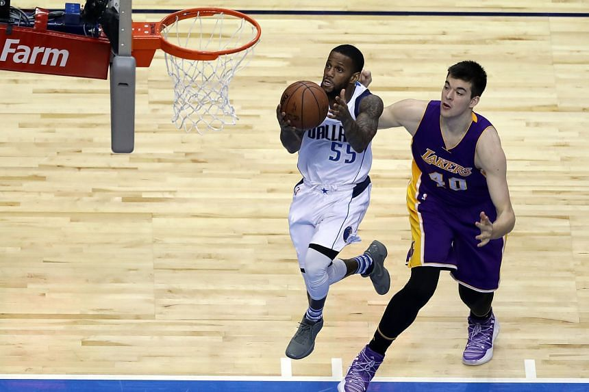 Pierre Jackson of the Dallas Mavericks drives to the basket against Ivica Zubac of the LA Lakers. The Dallas Mavericks crushed the LA Lakers 122-73.