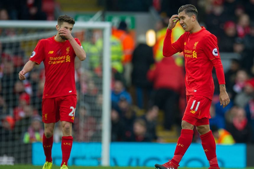 Liverpool's Adam Lallana (left) and Roberto Firmino face an uphill task to get the Reds back in the title hunt.