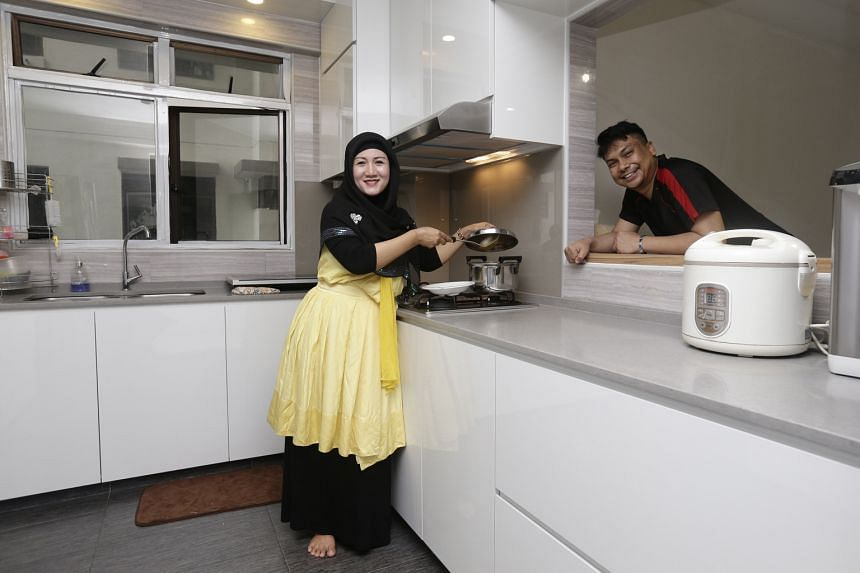 Mr Abdul Halil and his wife, Ms Stevanie Nur Rindyanie, in their renovated and fully furnished home. They had to live in a partially renovated flat (below) last year, after their interior designer left them in the lurch.