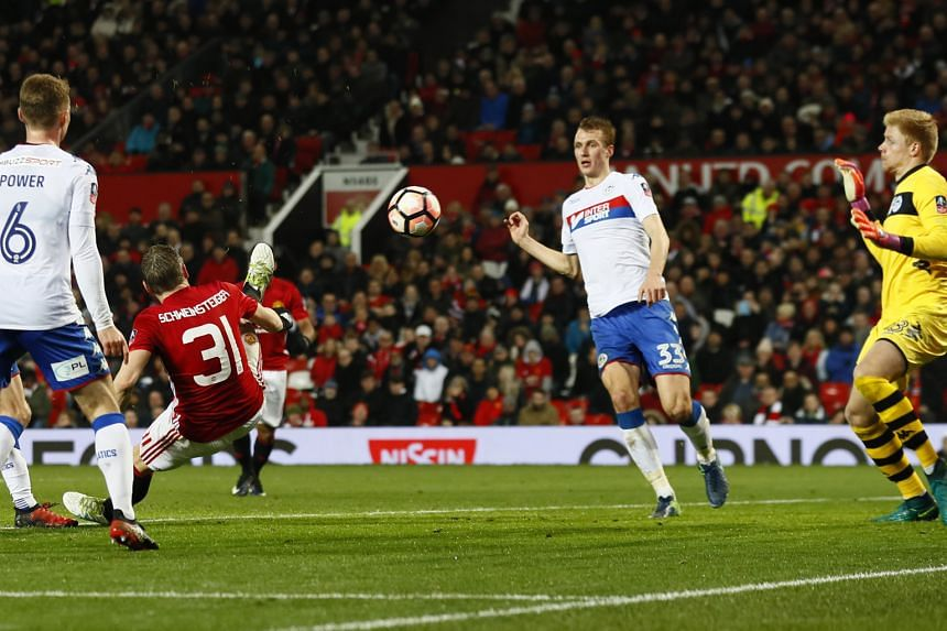 Bastian Schweinsteiger scoring Manchester United's fourth goal against Wigan in the fourth round of the FA Cup. United ran out comfortable 4-0 winners at home and remain in the hunt for four trophies - the Premier League, the League Cup, the FA Cup a