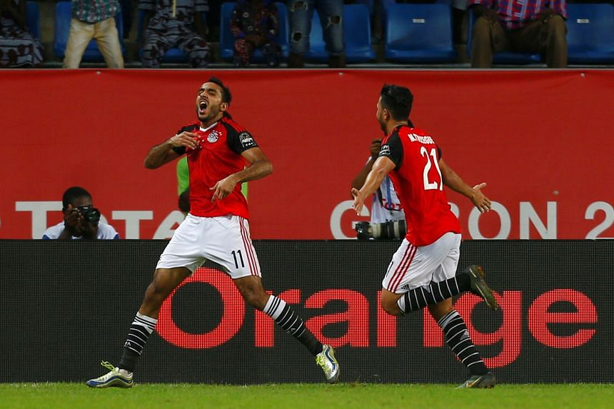 Egypt's Mahmoud Kahraba wheels away in jubilation after scoring in the 88th minute against Morocco. Egypt won 1-0 and will now face Burkina Faso in the semi-finals of the Africa Cup of Nations. Ghana take on Cameroon in the other semi-final.