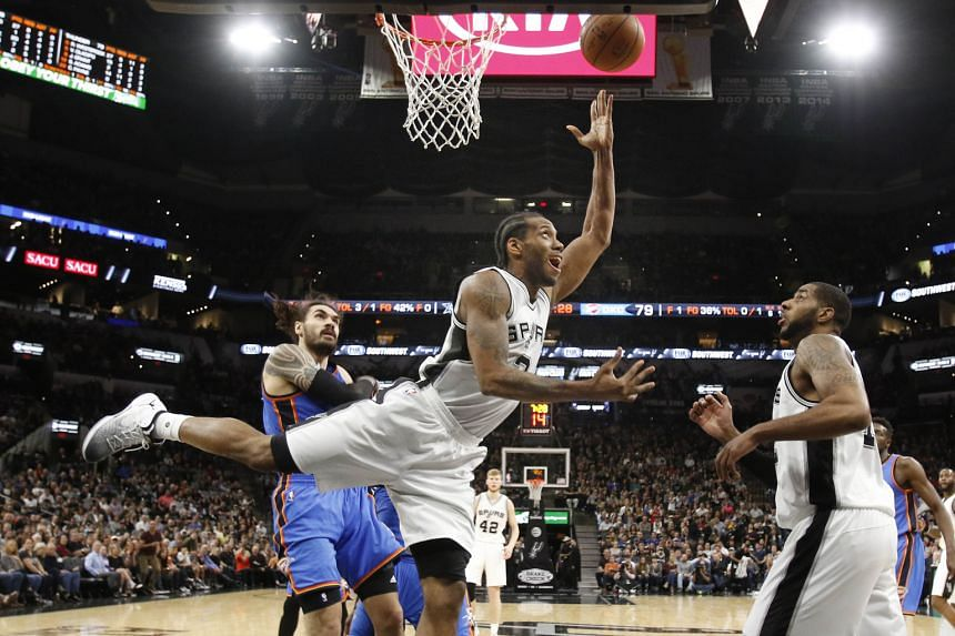Kawhi Leonard of the San Antonio Spurs displays balance and poise as he scores while Steven Adams of the Oklahoma City Thunder can only look on. Leonard scored 36 points as the Spurs won 108-94 on Tuesday.