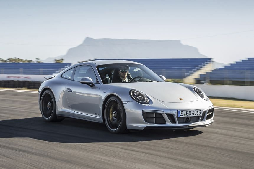 The Porsche 911 Carrera GTS uses the body of the all-wheel-drive Carrera 4, which has a wider rear track for enhanced roadholding.