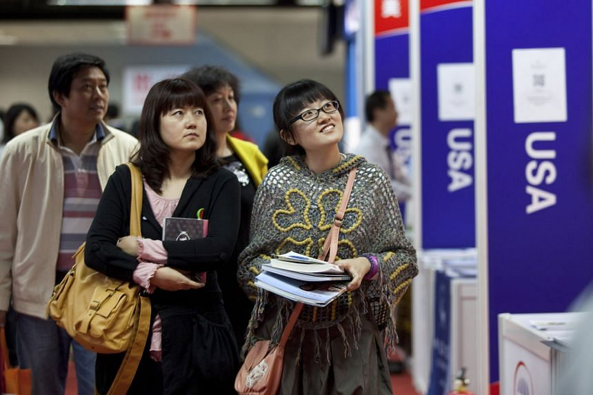 Chinese students and their parents at an education expo in Beijing. In 2005, only 641 Chinese students were enrolled in US high schools. By 2014, that student population was close to 40,000 - a sixty-fold increase in a single decade - and it now acco