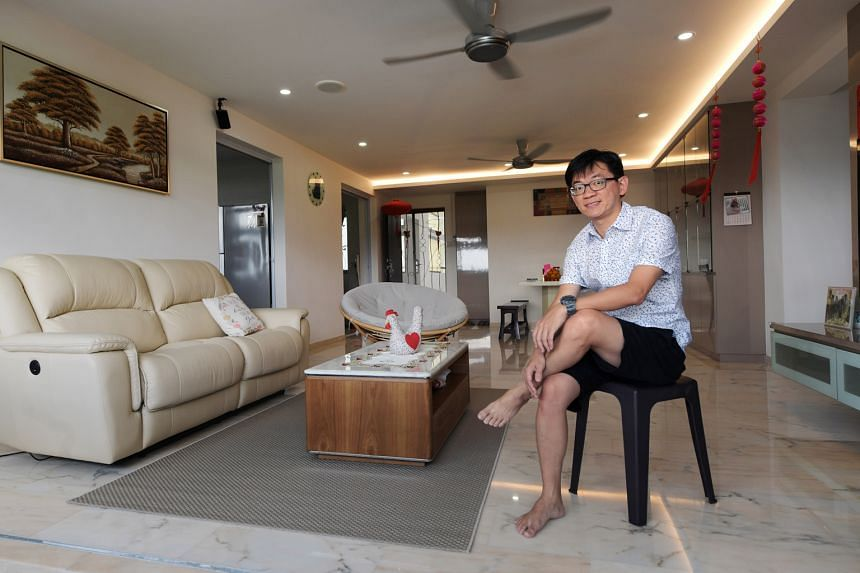 Mr Che at his HDB executive apartment in Bukit Batok. The first time he stepped into the living room, he was taken by its spaciousness. Spanning 1,600 sq ft, the apartment has four bedrooms. Tucked away amid an expanse of greenery, it is, nevertheles