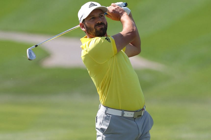 Sergio Garcia of Spain teeing off during the final round of the Dubai Desert Classic yesterday. With a 269 total, he became the seventh Spaniard to win the oldest professional golf tournament in the Middle East.